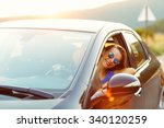 smiling woman driving a car at... | Shutterstock . vector #340120259
