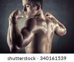 athletic man shows his muscular ... | Shutterstock . vector #340161539