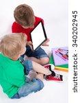 two schoolchildren sitting on a ... | Shutterstock . vector #340202945