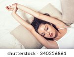 young beautiful  woman in bed... | Shutterstock . vector #340256861