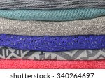 stack of cozy colorful sweaters | Shutterstock . vector #340264697
