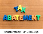 Small photo of tax abatement colorful word on the wooden background