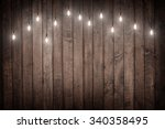 light bulbs on dark wooden... | Shutterstock . vector #340358495