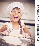 cooking is fun. little girl... | Shutterstock . vector #340408991