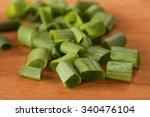 cut up green onions on wood