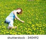 girl on dandelion lawn | Shutterstock . vector #340492