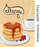 a plate of pancakes and a cup... | Shutterstock .eps vector #340515911