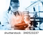 scientist writing report with... | Shutterstock . vector #340523237