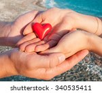 hands of man and woman holding... | Shutterstock . vector #340535411