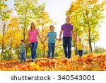 family walking together holding ... | Shutterstock . vector #340543001