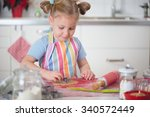 pretty little girl baking... | Shutterstock . vector #340572449