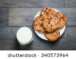 chocolate chip cookies  milk ... | Shutterstock . vector #340573964