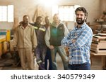 a smiling carpenter with his... | Shutterstock . vector #340579349