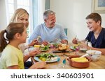 family sitting at table... | Shutterstock . vector #340603901
