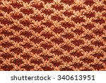 Brown Knitted Cloth Is Made By...