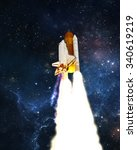 Space Shuttle Launches Into...