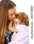 lovely little girl cuddling  up ...   Shutterstock . vector #34073887