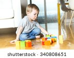 a kid playing toy blocks inside ... | Shutterstock . vector #340808651