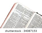 Small photo of holy bible open to the epistle of paul the apostle to the galatians, against a white background