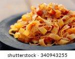 tagliatelle with tomato sauce... | Shutterstock . vector #340943255