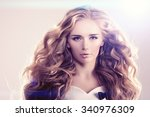 model with long hair blonde... | Shutterstock . vector #340976309