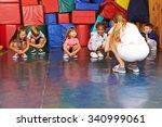 children doing gymnastics in... | Shutterstock . vector #340999061