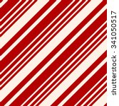 Christmas Seamless Vector Pattern. Contain candy cane stripes in red and cream colors. Great for wrapping paper and wallpapers.