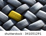 yellow tire in a stack of tires