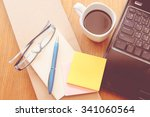 note book and laptop on wooden... | Shutterstock . vector #341060564