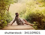 Beautiful Girl On Old Wooden...