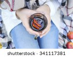 young woman drinking hot mulled ... | Shutterstock . vector #341117381