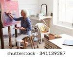 female artist working on... | Shutterstock . vector #341139287