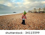 child at seaside on beach in... | Shutterstock . vector #34115599