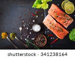Stock photo raw salmon fillet and ingredients for cooking on a dark background in a rustic style top view 341238164