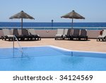 swimming pool and sun lounger... | Shutterstock . vector #34124569