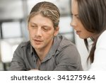 young coworkers working... | Shutterstock . vector #341275964