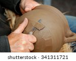 Stock photo a professional potter creating a replica of a medieval cooking pot 341311721