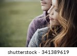 young loving couple outdoors... | Shutterstock . vector #341389619