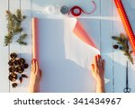 gift wrapping. woman packs... | Shutterstock . vector #341434967