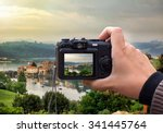 hand holding the Digital camera, shoot of landscape photo using liveview - stock photo