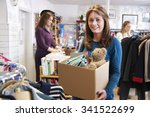 woman donating unwanted items... | Shutterstock . vector #341522699