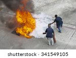volunteer try to extinguish the ... | Shutterstock . vector #341549105