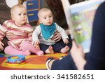 mothers with children at baby... | Shutterstock . vector #341582651