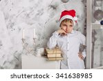 child in santa hat sits near... | Shutterstock . vector #341638985