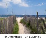 sunny beach with sailboat and...   Shutterstock . vector #341668469