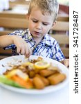 cute child eating alone with... | Shutterstock . vector #341728487
