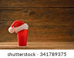 paper coffee cup with santa's... | Shutterstock . vector #341789375