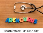Small photo of adenovirus colorful word on the wooden background with stethoscope