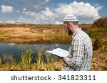 young man praying and reading... | Shutterstock . vector #341823311