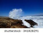 Wave Spray Over Rocks